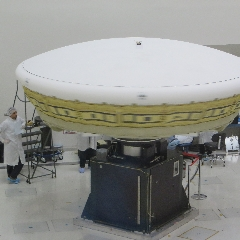 Caption: A six-meter Supersonic Inflatable Aerodynamic Decelerator (SIAD) is spin tested in a JPL clean room., Credit: Mat Kaplan