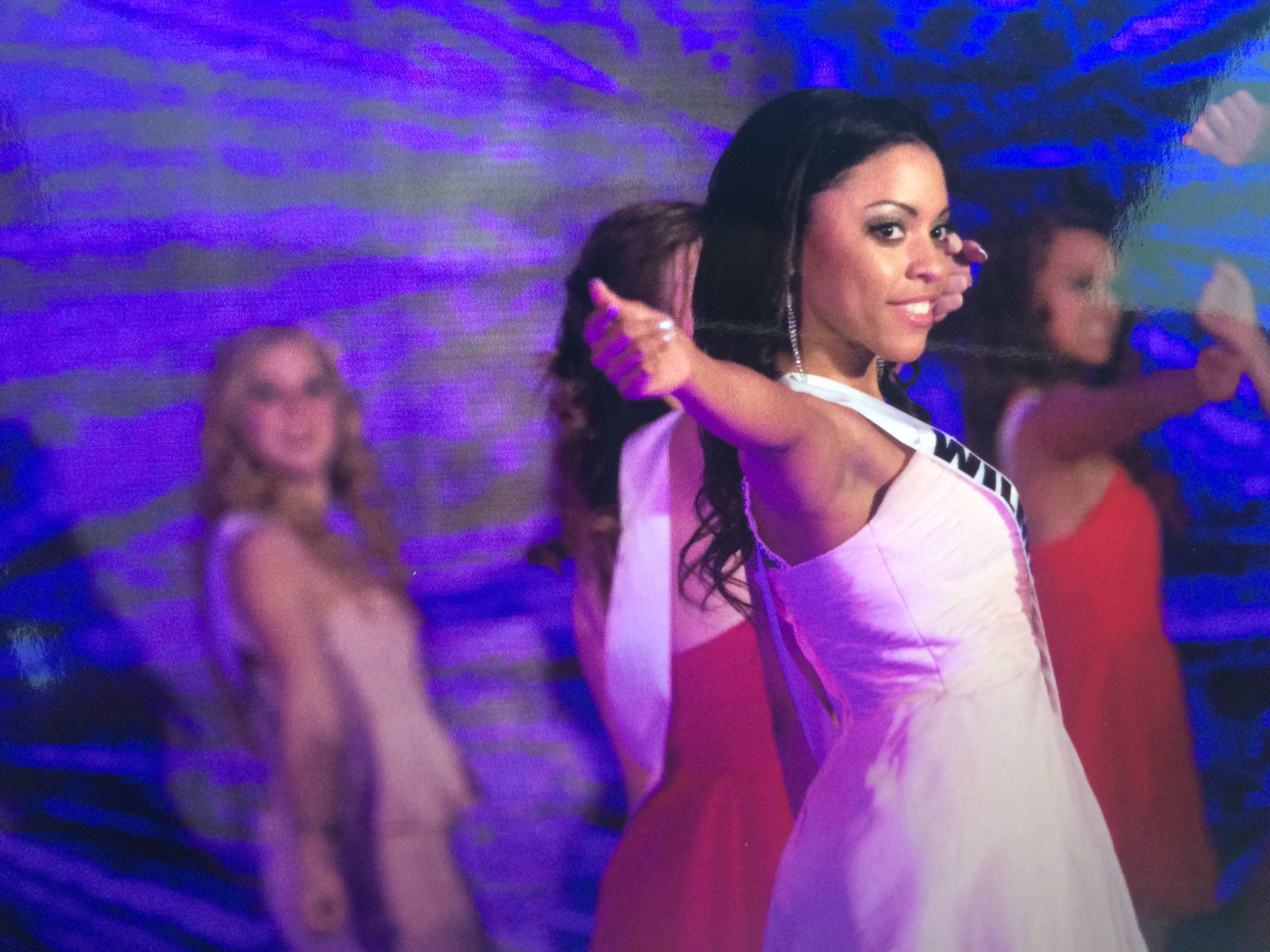 Caption: Cierra Smith on stage at the Miss Delaware Teen USA 2015 Pageant.