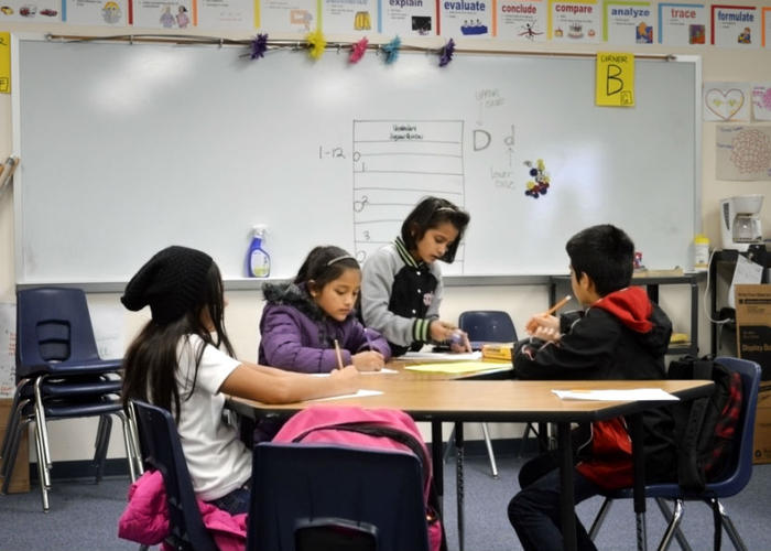 Caption: Students at the Newcomer Academy in Fort Worth ISD, Credit: Christina Ulsh