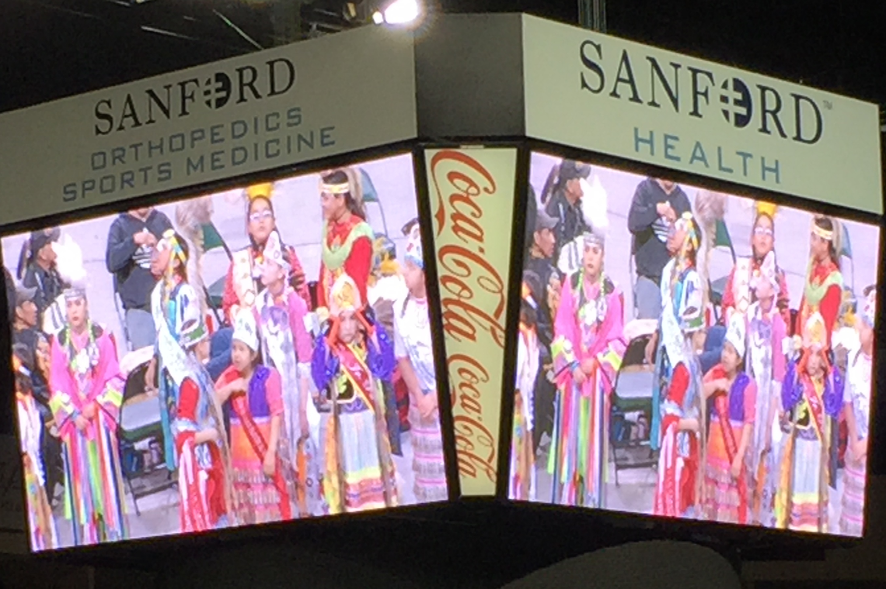 Caption: Pow wow dancers were on the big screen at Bemidji's Sanford Center Arena., Credit: Melissa Townsend