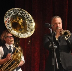 Caption: Preservation Hall Jazz Band make their debut on the WoodSongs Stage.