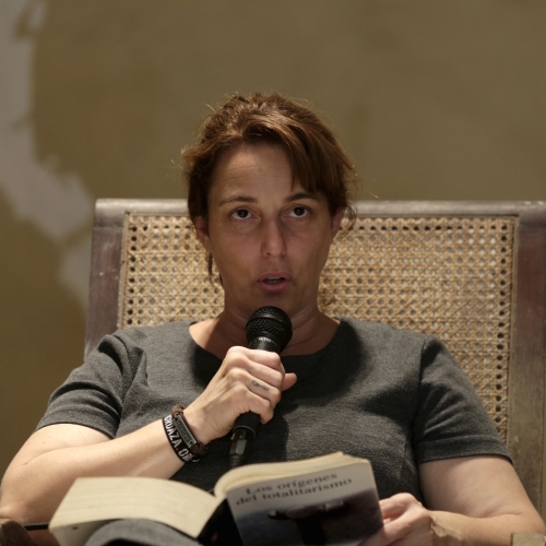 Caption: Tania Bruguera reading Hannah Arendt in Havana, Credit: Enrique de la Osa, via PRI