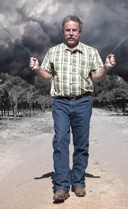 Caption: Marc Mondavi demonstrates his divining rods.