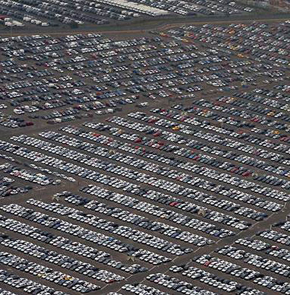 Caption: Imported cars awating delivery, Credit: businessinsider.com/unsold-cars-around-the-world-2009-2
