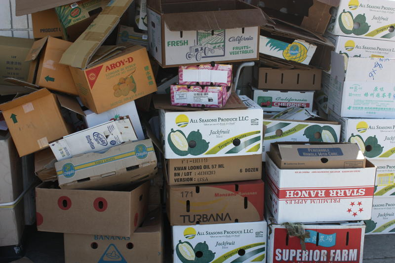 Caption: Empty produce boxes outside of Oakland's Sun Hop Fat Market, Credit: Hannah Kingsley-Ma