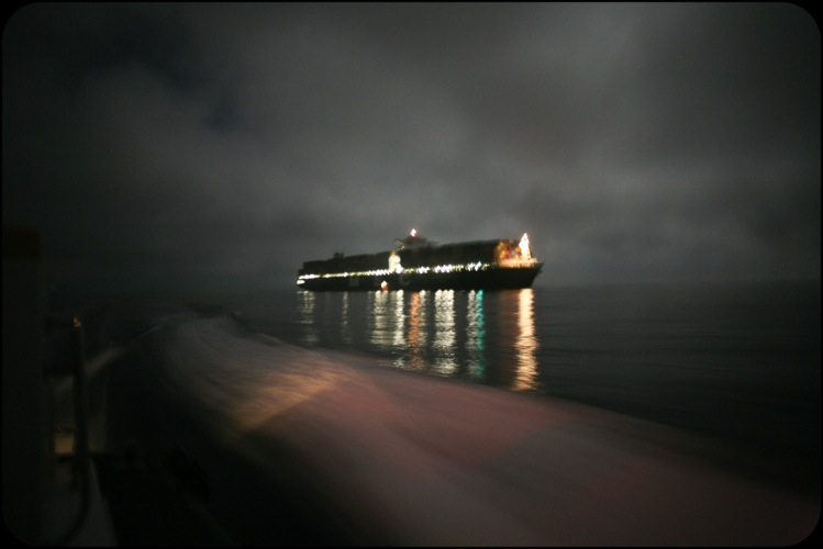 Caption: M.S.C. Valeria, the largest ship to call in any American port, cruising into Long Beach harbor on a foggy night. , Credit: Lu Olkowski