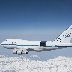 Caption: With the sliding door over its 17-ton infrared telescope wide open, NASA's Stratospheric Observatory for Infrared Astronomy – or SOFIA – soars over California's snow-covered Southern Sierras., Credit: NASA/Jim Ross