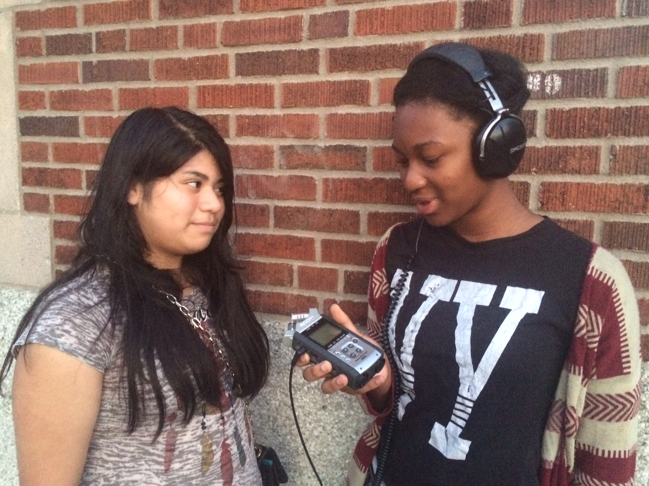 Caption: Leslie being interviewed by Tyesha