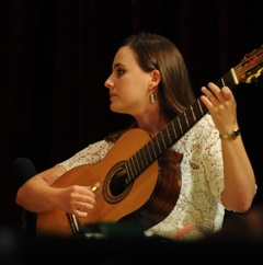 Caption: Lia from Brazil's Choro das 3 on the 7 string guitar.