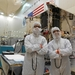 Caption: PI Dante Lauretta (r.) and Kevin Walsh in the Lockheed Martin clean room with OSIRIS-REx, Credit: Dante Lauretta
