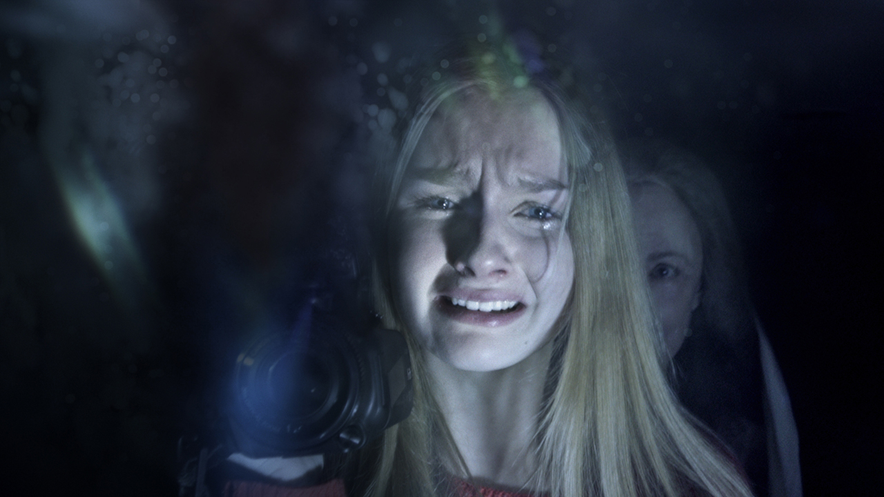 Caption: Olivia DeJonge and Deanna Dunagan in Night Shyamalan's 'The Visit'