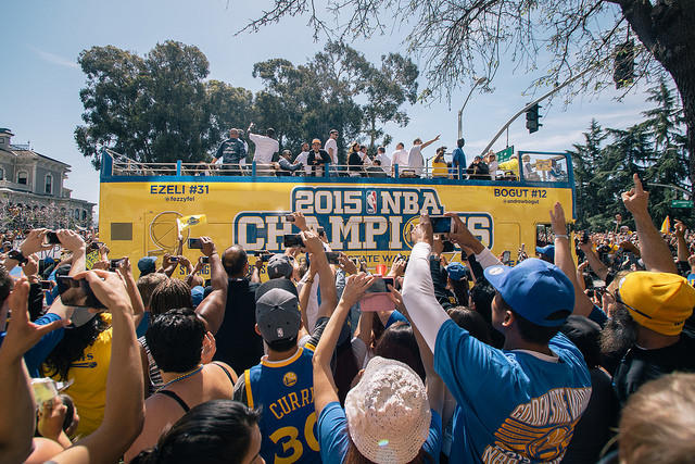 Caption: Golden State Warriors fans paraded through Oakland following victory, Credit: AMIR AZIZ FROM FLIKR CREATIVE COMMONS
