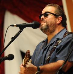 Caption: Raul Malo and The Mavericks on the WoodSongs Stage.