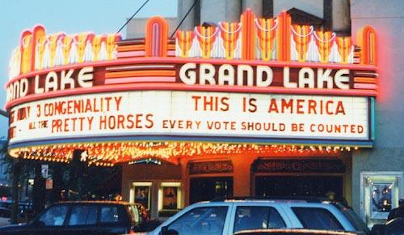 Caption: Following the Supreme Court decision to stop the vote count in Florida, during the 2000 presidential election, theater owner, Allen Michaan, began posting messages on the marquee.