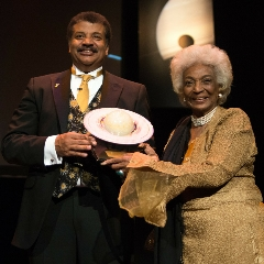 Caption: Nichelle Nichols presents the Cosmos Award to Neil deGrasse Tyson, Credit: Navid Baraty/The Planetary Society