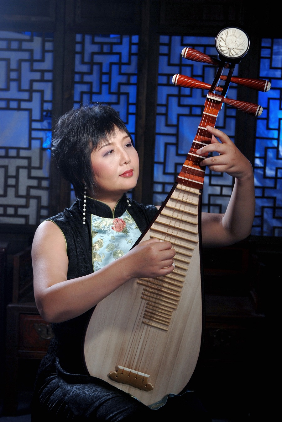 Caption: Gao Hong w/pipa, Credit: Photo Provided by World Music Professionals