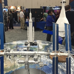 Caption: NASA spacecraft models at SpaceCom Expo, Credit: Mat Kaplan