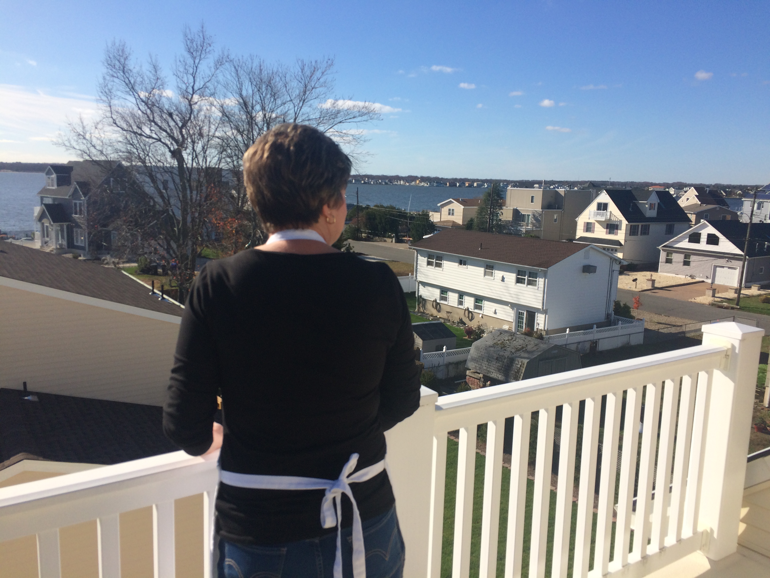 Caption: Anne Berardi says a lot has changed after the storm as she overlooks her neighborhood from her balcony., Credit: Colleen Callander