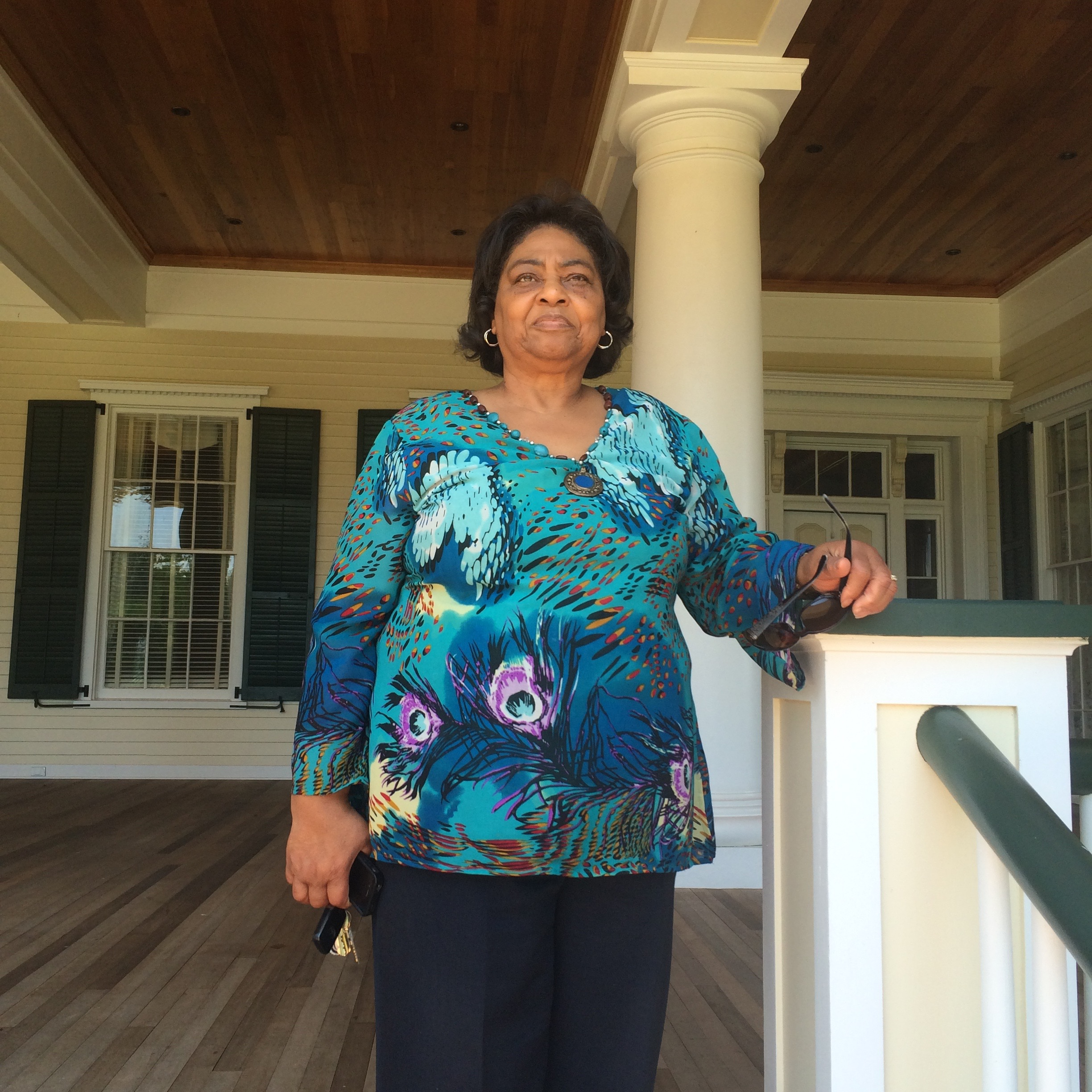 Caption: Shirley Sherrod on the porch of the antebellum mansion at Resora Plantation , Credit: Photo by Tina Antolini.