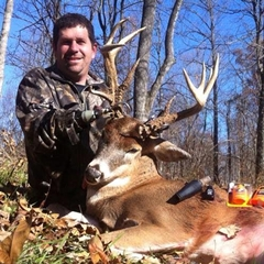 Caption: Jason Koger with a Big Whitetail Buck , Credit: Jason Koger