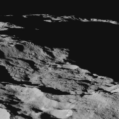 Caption: Dawn had this view of Ceres at 86 degrees south latitude on Dec. 10, only three days after completing its descent to an average orbital altitude of 240 miles (385 kilometers). , Credit: NASA / JPL-Caltech / UCLA / MPS / DLR / IDA