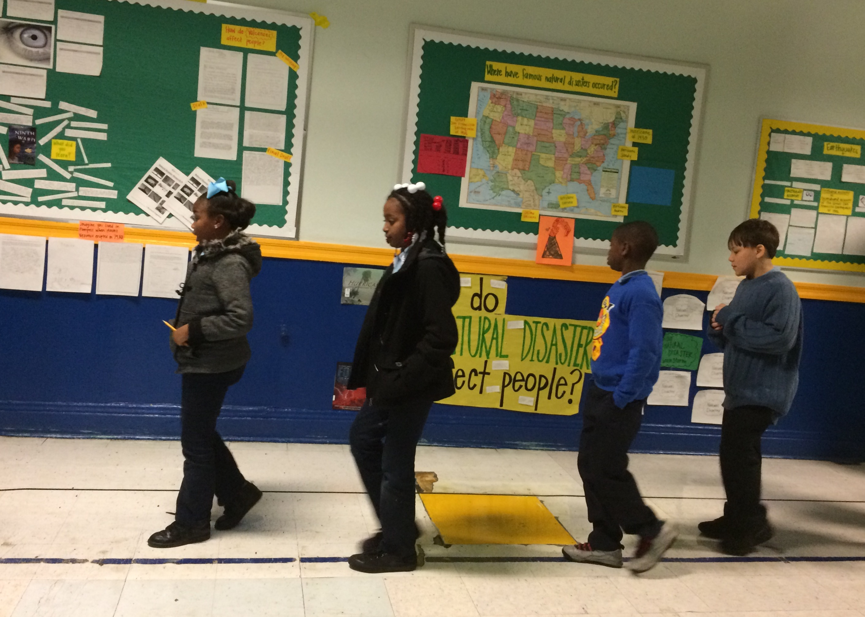 """Caption: Students at Renew Cultural Arts Academy in New Orleans return to class after their morning """"value summit."""", Credit: Mallory Falk, WWNO"""