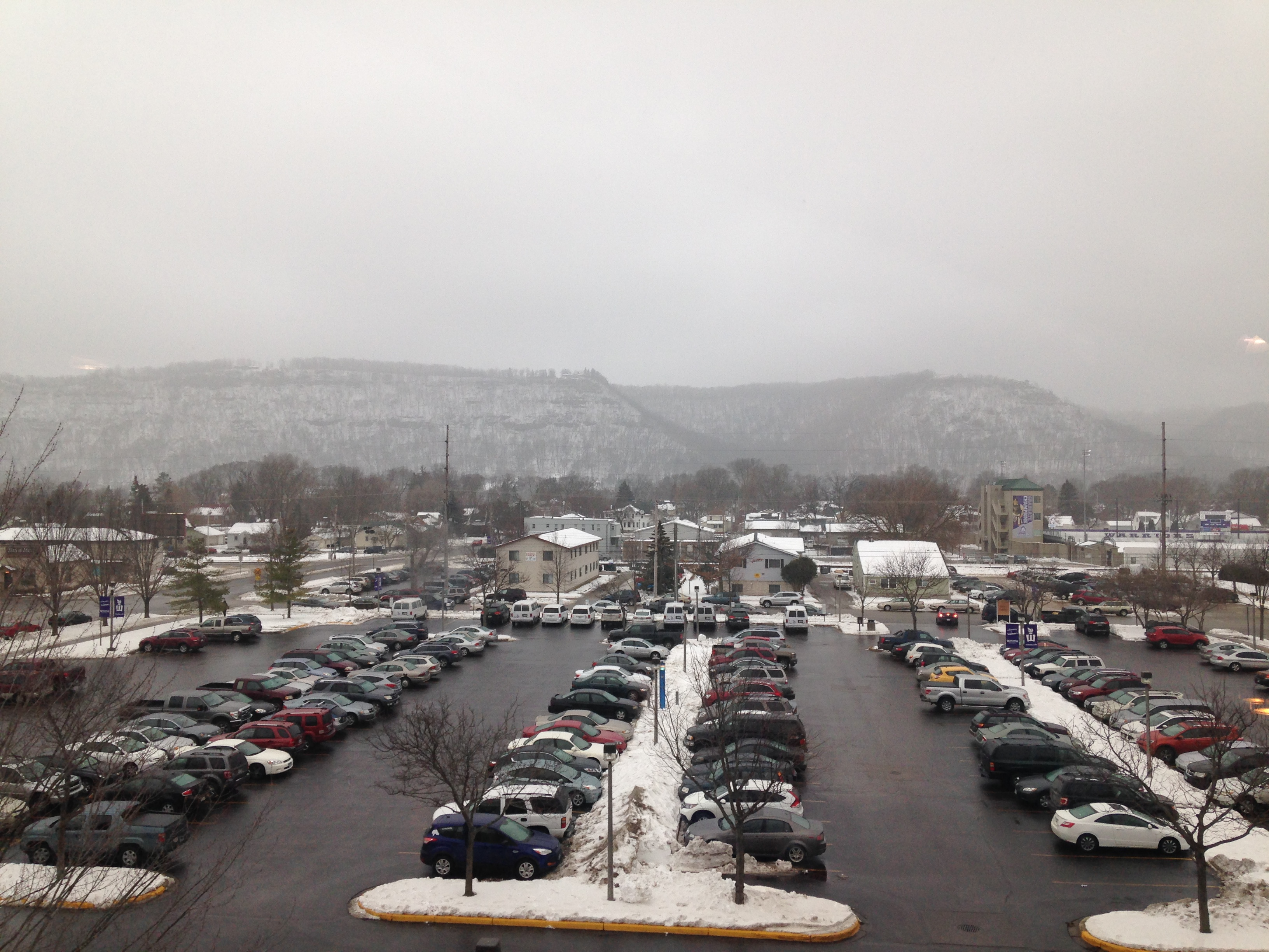 Caption: View of the Winona Bluffs from WSU Campus, Credit: Teri Tenseth Market