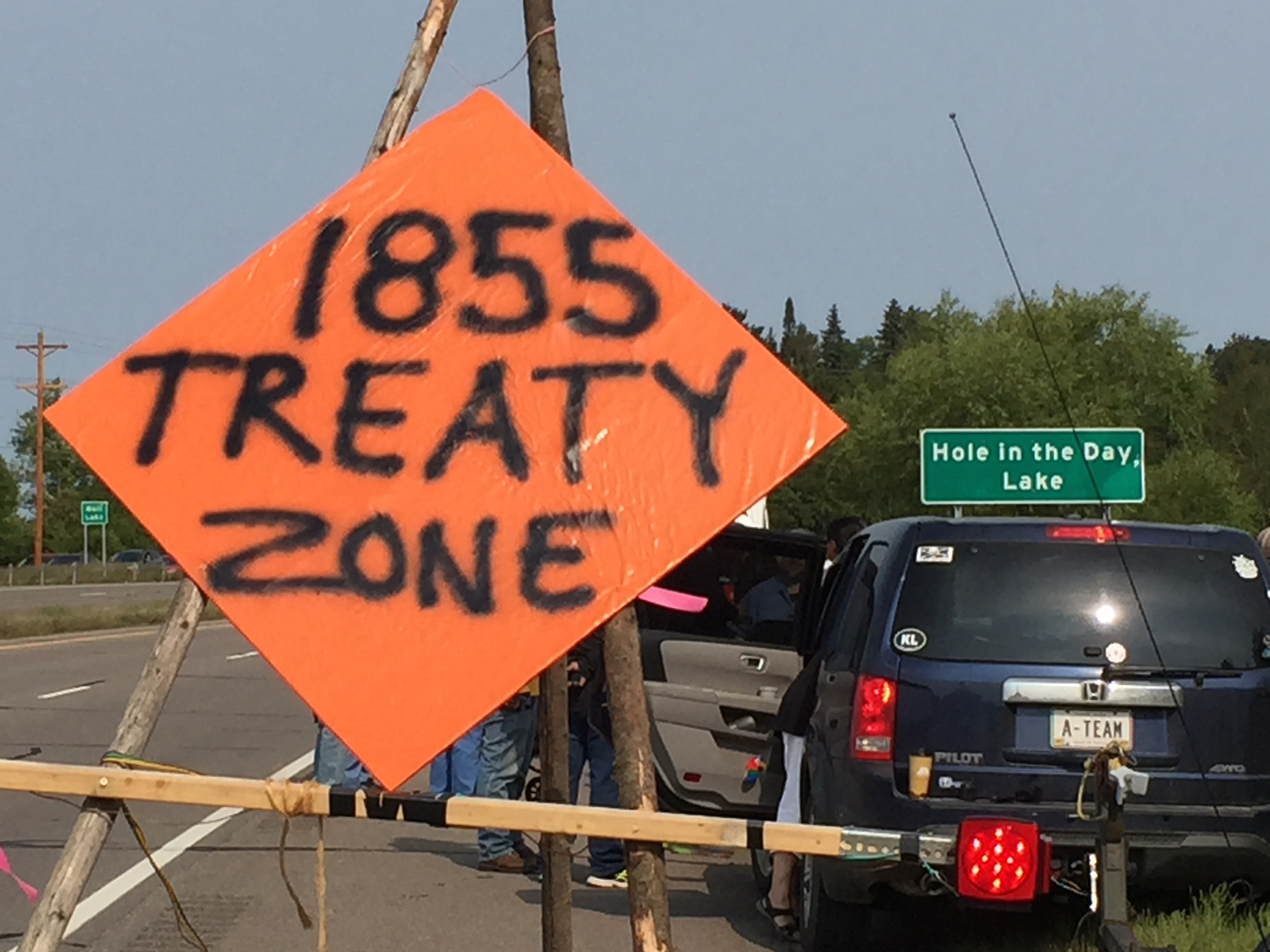 Caption: Protestors with The 1855 Treaty Authority gather outside Nishwa, MN in August 2015. , Credit: Melissa Townsend