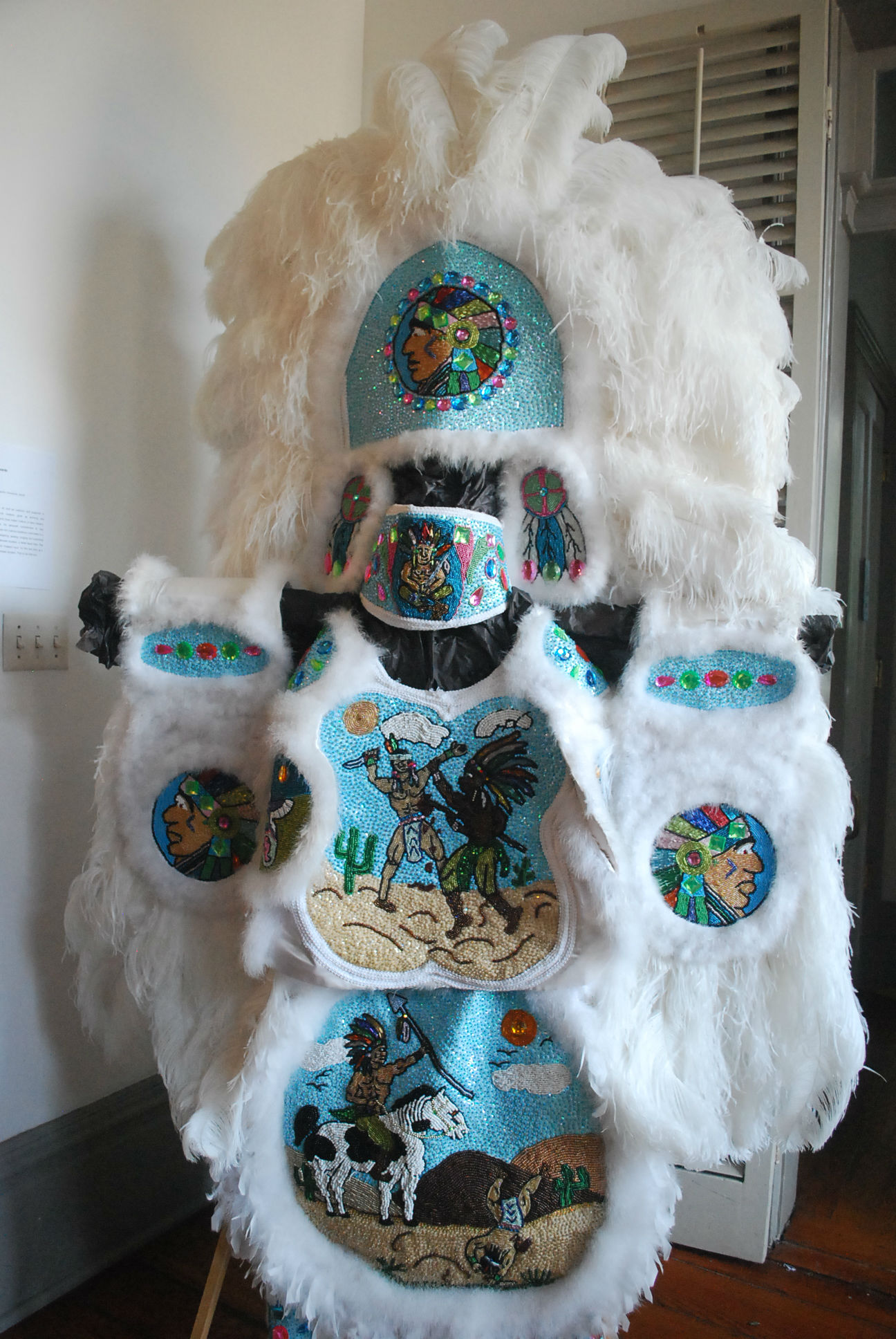 Caption: Mardi Gras Indian costume at New Orleans' African American Museum., Credit: Tonya Fitzpatrick