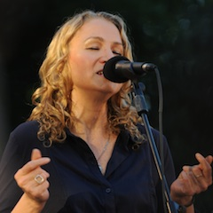 Caption: Joan Osborne on the WoodSongs Stage.