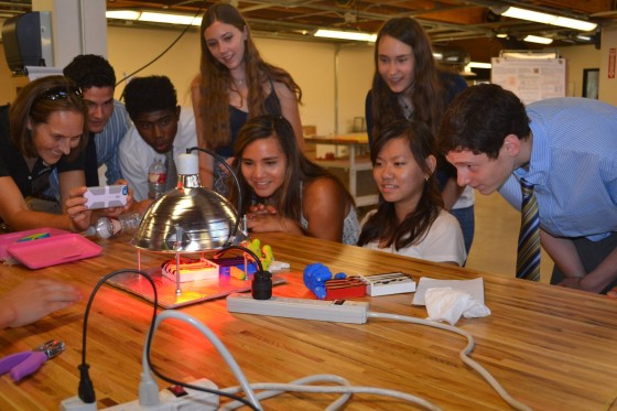 Caption: High school researchers in CU Boulder program observing photo-origami model. Photo credit: Stacey Forsyth