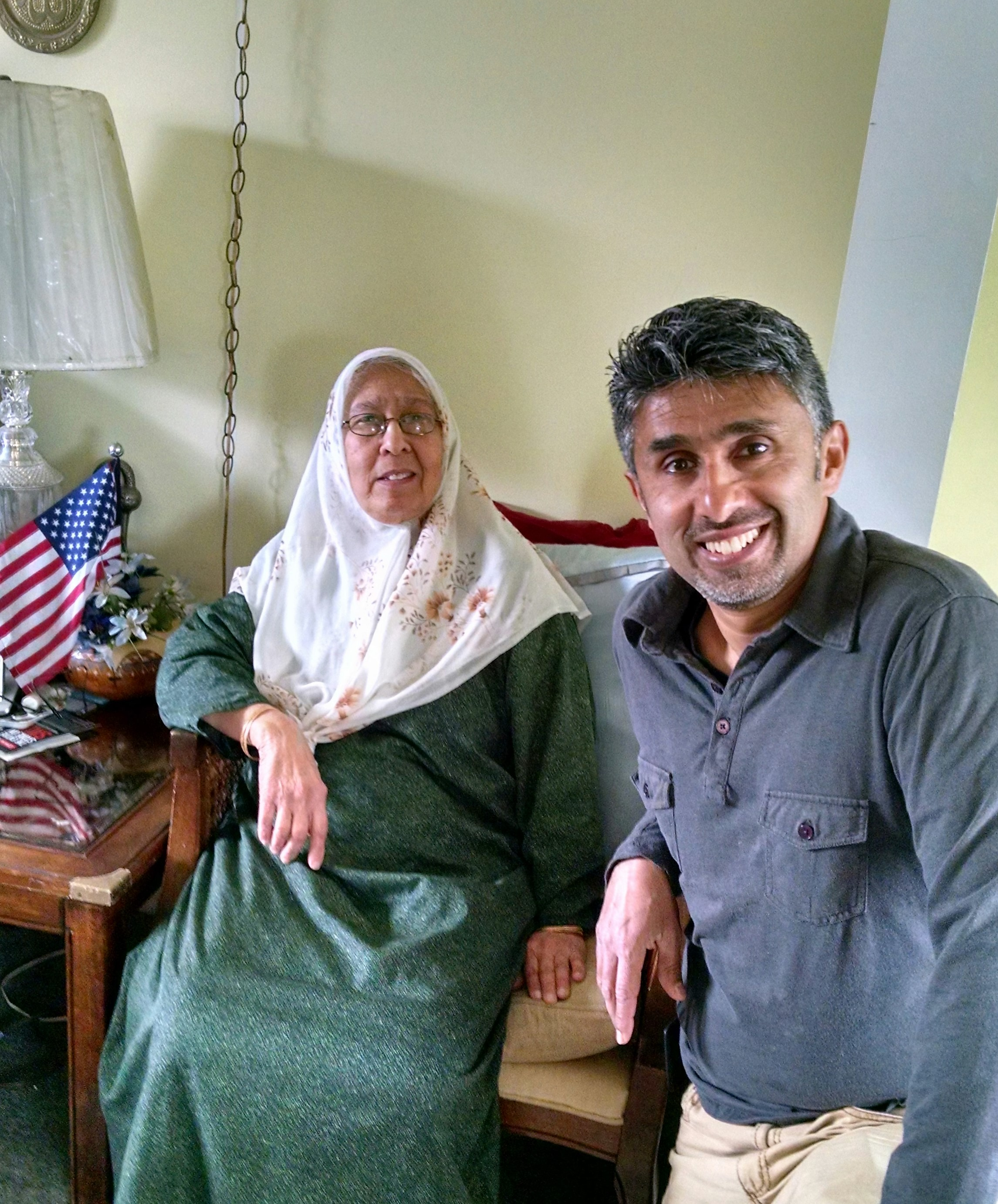 Caption: Saber and Muzzamil at Saber's home. She bought a few American flags after 9/11 and put them around  her house, Credit: Renee Gross