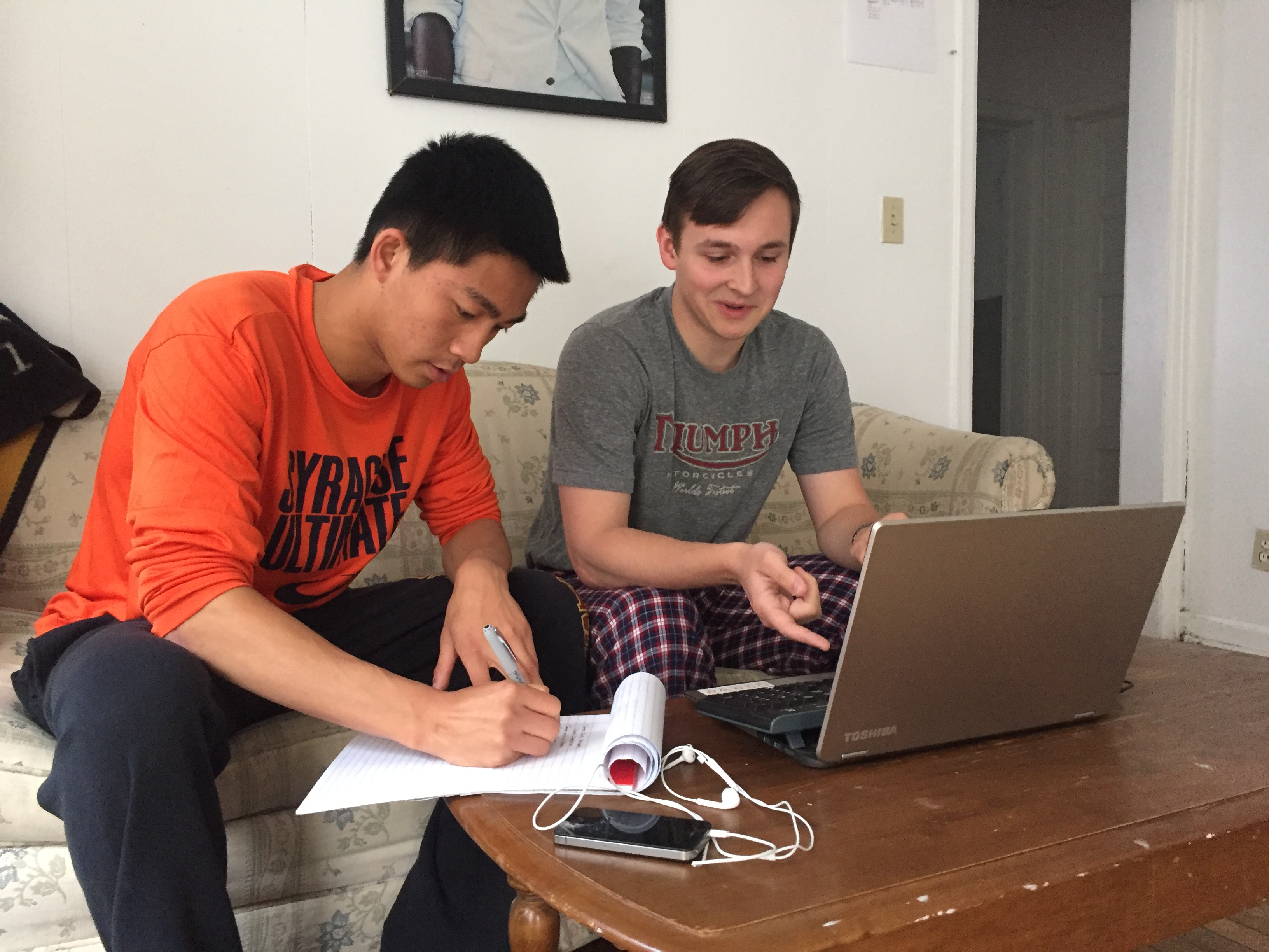 Caption: Brandon Eng and Mark Skinner work in the comfort of Skinner's house where Eng has been sleeping on the couch the past year.  , Credit: (c) 2016 Tara Lanigan