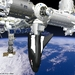 Caption: Artist's rendering of SNC's Dream Chaser berthed with the International Space Station, Credit: Sierra Nevada Corporation