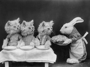 Caption: A rabbit serves a meal to three kittens (Harry Whittier Frees, c1870)