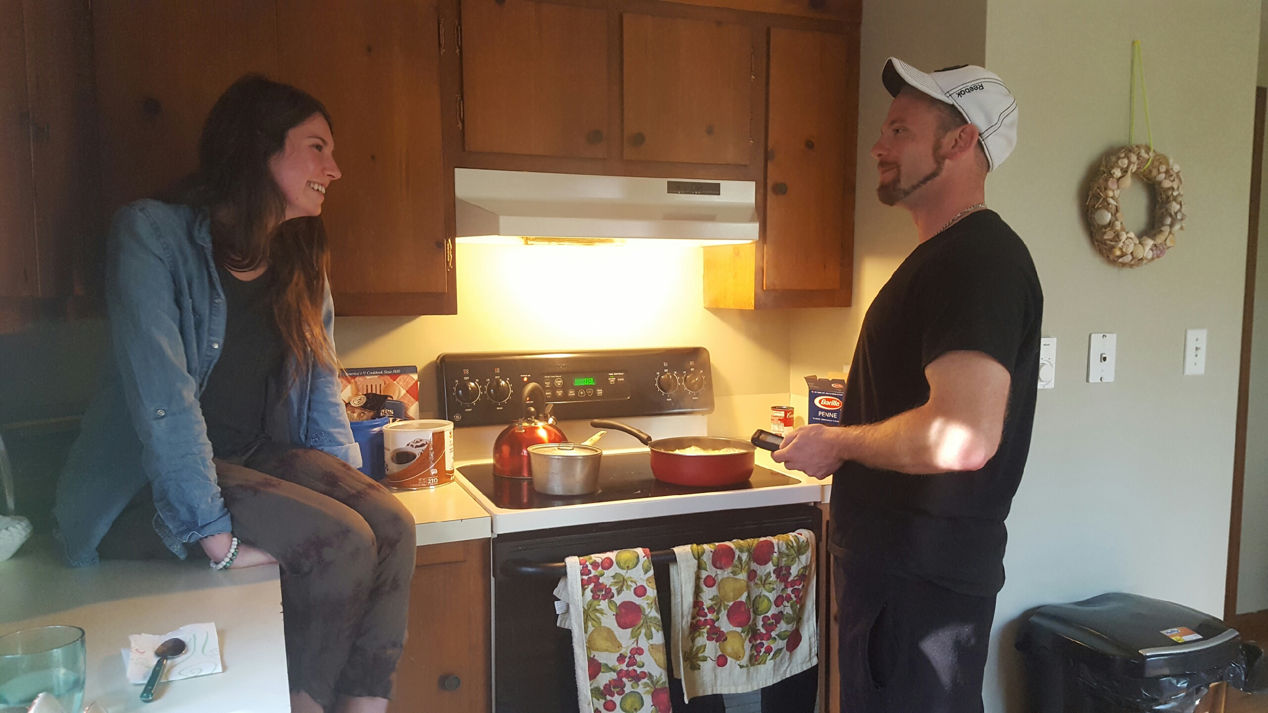 Caption: Jake Pickard and Marirose Lynch enjoy cooking together in his apartment, Credit: Elizabeth Nakano