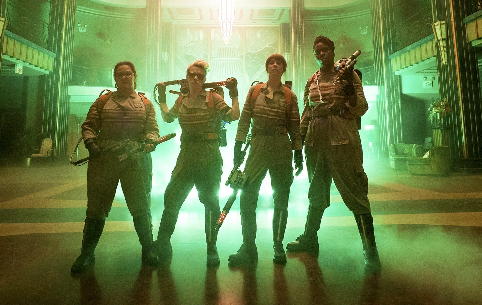 Caption: Melissa McCarthy, Kate McKinnon, Kristen Wiig and Leslie Jones in 'Ghostbusters'
