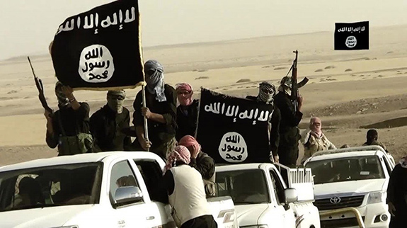 Caption: ISIS fighters drive around waving flags, Credit: Day Donaldson/Flickr