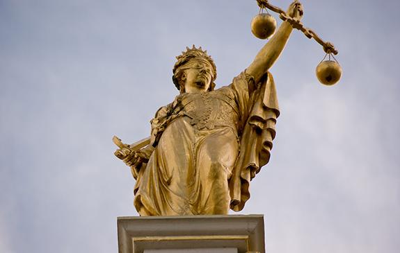 Caption: Lady Justice, Credit: Emmanuel Huybrechts/Flickr