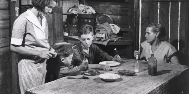 "Caption: ""Family at table eating,"" Okefenokee Swamp, Georgia., Credit: Margaret Bourke-White, You Have Seen Their Faces"