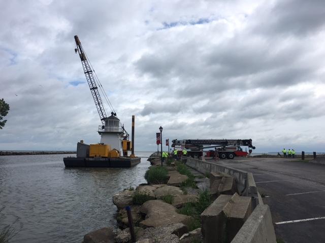 Caption: Port Clinton lighthouse moves by barge, Credit: Elizabeth Miller