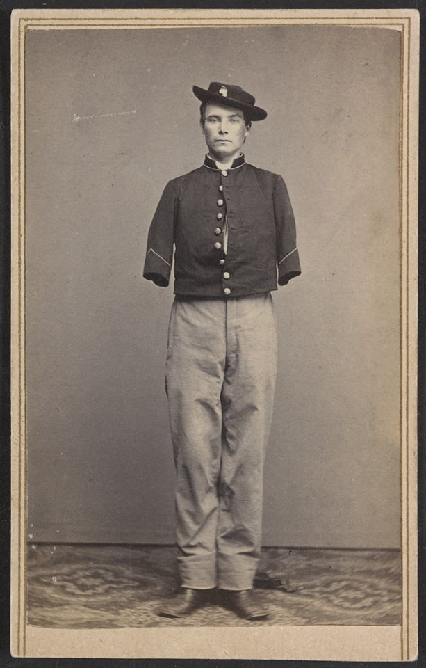 Caption: Private William Sergeant, in uniform after the amputation of both arms. , Credit: Credit: Library of Congress.