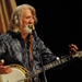 Caption: John McEuen tells an amusing story to the WoodSongs audience.