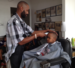 Caption: Milan Dennie and other barbers at this St. Paul shop provided 350 free haircuts on the day before school started., Credit: Nancy Rosenbaum