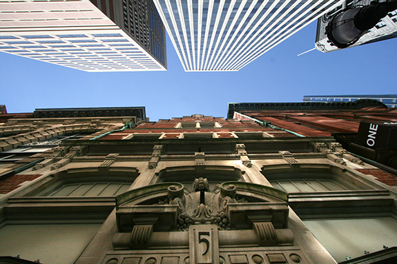 Caption: A street level shot looking straight up between two differently styled buildings in Baltimore- one modern and sleek and the other dripping with oldword craftsmanship., Credit: Urbanfeel/Flickr