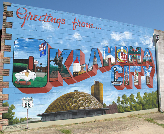 """Caption: A painted mural saying """"Greetings from Oklahoma City"""", Credit: Matthew Rutledge/Flickr"""
