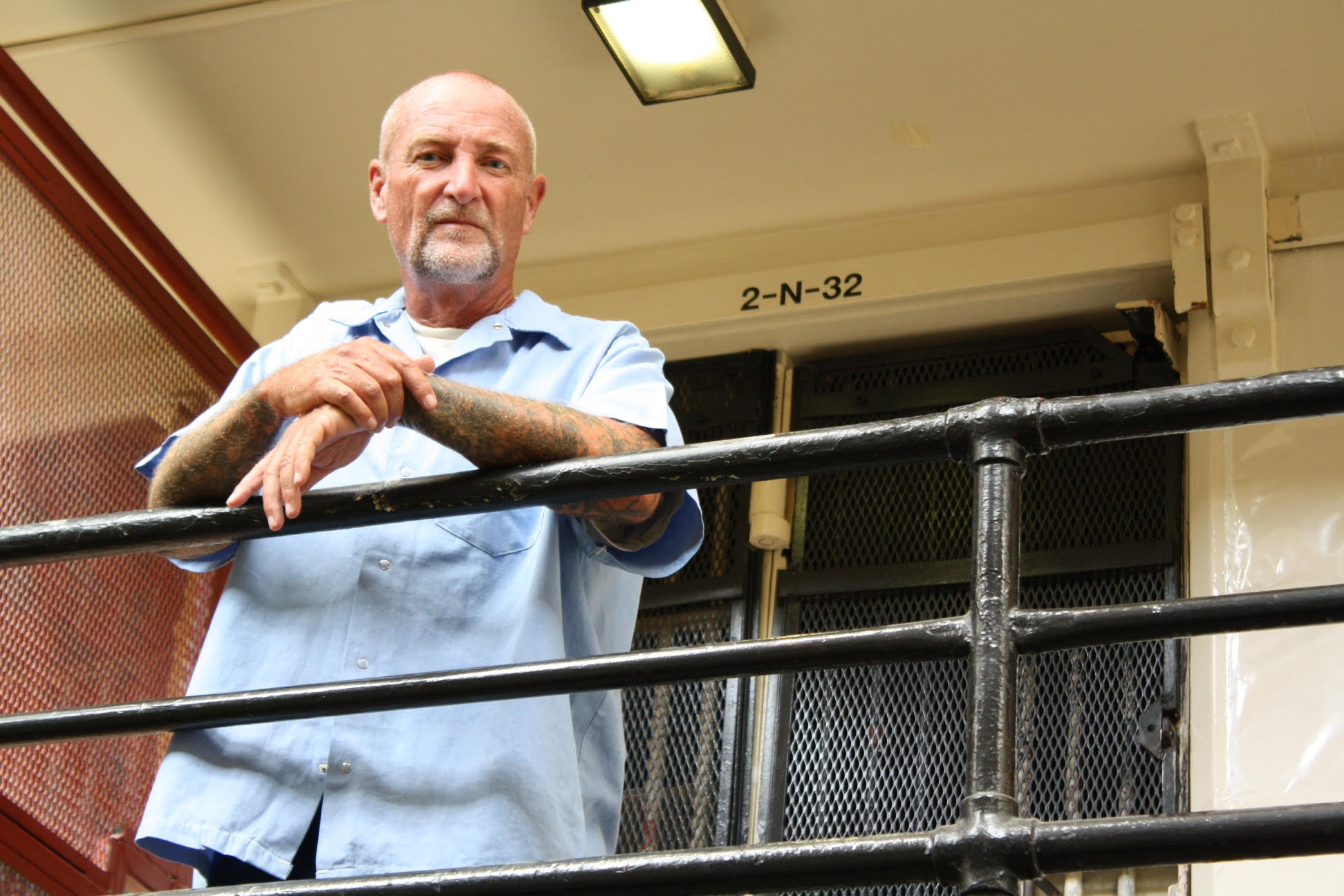 Caption: Douglas Collier outside his cell, Credit: Greg Eskridge and Elisabeth Fall