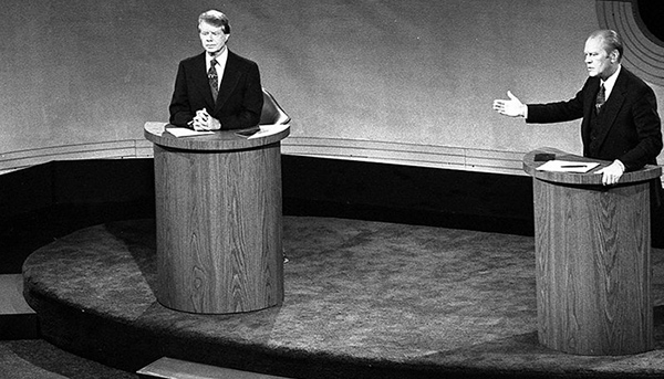 Caption: President Gerald Ford and Jimmy Carter meet at the Walnut Street Theater in Philadelphia to debate domestic policy during the first of the three Ford-Carter Debates. , Credit: Source: Wikimedia Commons