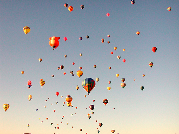 Caption: A sky filled with hot air balloons, Credit: a4gpa/Flickr