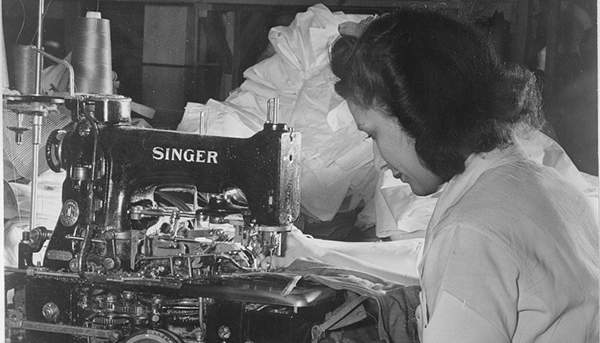 Caption: Best Coat and Apron Mfg. Company : Attaching trouser buttons with automatic button-fastening machine, Credit: Source: Library of Congress